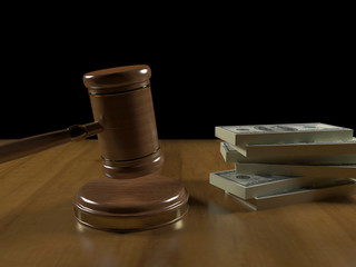 Gavel and money on the judge's desk