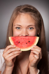 Women with a slice of melon