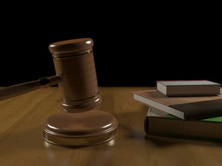 Gavel and books on the judge's desk