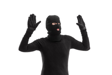 Thief in black costume surrendering to someone
