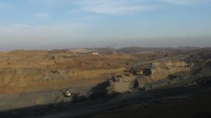 Timelapse. Excavator loading huge dump trucks