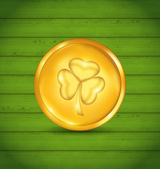 Golden coin with clover on green wooden texture for St. Patrick'