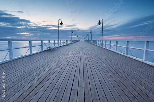 Beautiful long exposure seascape with wooden pier - 81951641