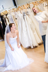 Bride: Woman Wearing Gown and Laughing At Friend