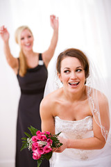 Bride: Bride Ready To Throw Bouquet To Friends