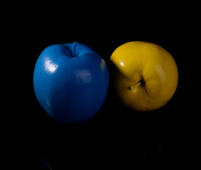Yellow apple and blue apple.