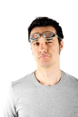 Studio shot of a young man with swimming goggles