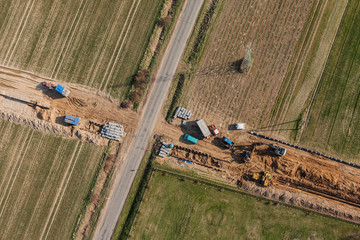 aerial view of burying gas pipe in a country area in Poland