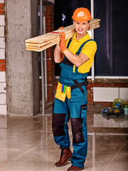 Man in builder uniform.