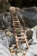 wooden access ladder on cliff