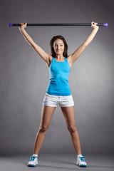 Studio shot of athletic woman exercising fitness