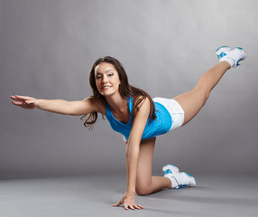 Sporty woman posing at camera during workout