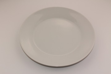 An empty white plate isolated on a white background