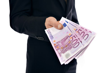 A businessman holding money - Euro (EUR) - isolated