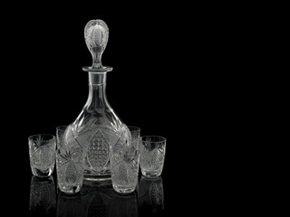 Cut crystal decanter and six piles