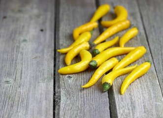 chili yellow peppers as ingredients of food.