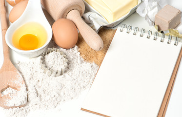 Recipe book and baking ingredients. Food background