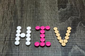 The word HIV(Human Immunodeficiency Virus) written whith pills o