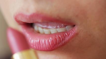 Lipstick on beautiful lips of woman