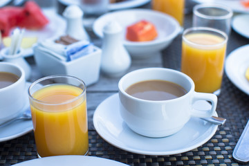 Delicious tasty cappuccino and fresh juice for breakfast at