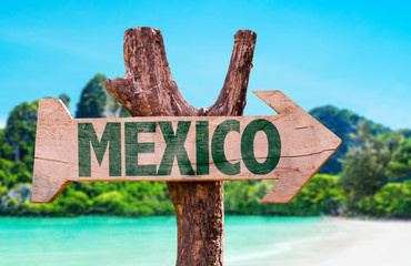 Mexico wooden sign with beach background