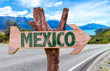 Mexico wooden sign with road background