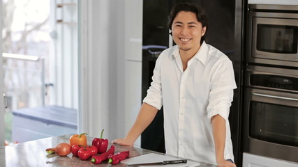 Young masterchef in kitchen with vegetables
