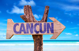 Cancun wooden sign with beach background - 81959449