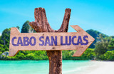 Fototapety Cabo San Lucas wooden sign with beach background