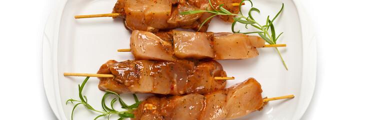 Raw chicken kebab. Panoramic image. Selective focus.