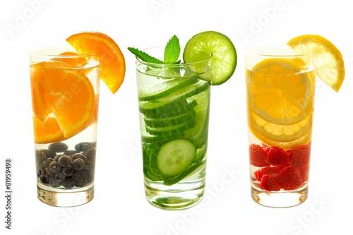 Leinwandbild Motiv Detox water with fruit in glasses isolated on white