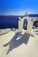 Long belfry shadow on the roof of Santorini Church, Greece