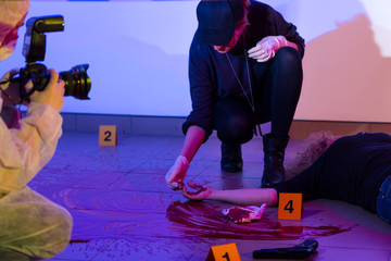Criminalist working on a crime scene