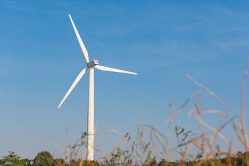 Wind turbine over blue sky background on a sunny day
