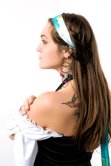 Young woman dressed in gipsy dress, profile
