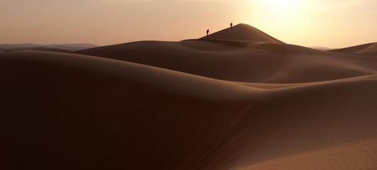 People walking in a dune's desert