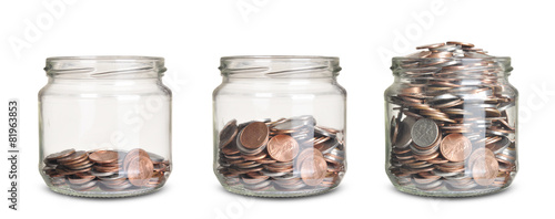 jars with different level of coins isolated on white - 81963853
