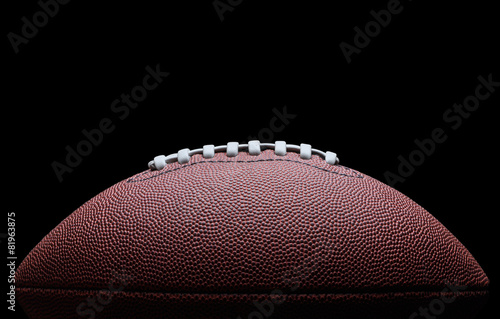 American football over black background - 81963875