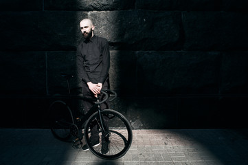 guy in black clothes with fix bike