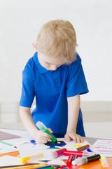 boy draws