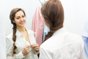 Girl at boutique changing cubicle