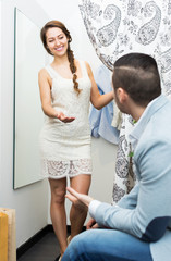 Couple at boutique changing cubicle