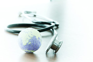 Studio macro of a stethoscope and texture globe with shallow DOF