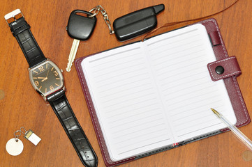 Notebook, watch and car keys.