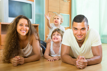 Happy family of four at home