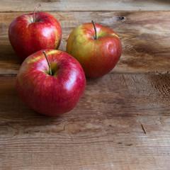 three red ripe apple