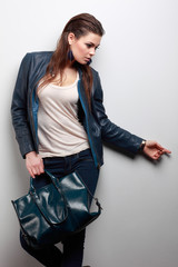 beautiful girl is in fashion style on grey background, glamour