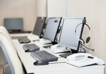 Computers With Headphones At Workplace