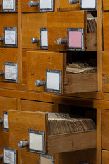 Old wooden card catalog with  opened drawer