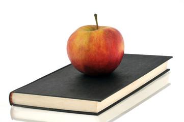 la pomme sur le livre